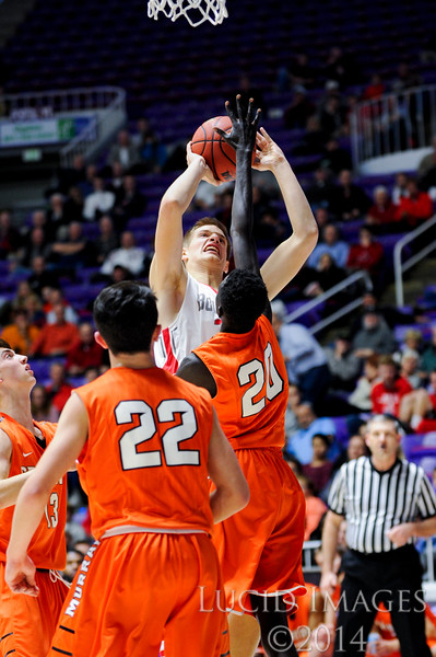 Bountiful forward Collin Parrish (33) has to work to get above Murray defender Sunday Arok (20) to make a lay up in the first round of the 4A Boys State Championships at the Dee Events Center in Ogden on February 24, 2015.