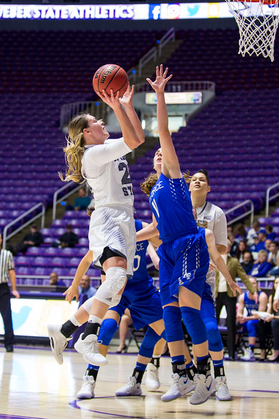 Emily Drake (20), makes a tough lay-up after driving from the perimeter, over the defense of Cortney Porter (11), of Air Force, at the Dee Events Center, in Ogden, on Saturday, December 9, 2017.