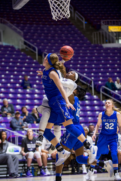 Jaiamoni Welch-Coleman (0), of Weber State, draws the foul from Cortney Porter (11), after a fast break opportunity, sending her to the free throw line, at the Dee Events Center, in Ogden, on Saturday, December 9, 2017.
