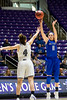 Cortney Porter (11), of Air Force, banks in a three point shot as the shot clock buzzer sounds over the defense of Weber State player. Kailie Quinn (4), at the Dee Events Center, in Ogden, on Saturday, December 9, 2017.