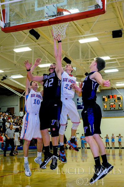 Brenden Morris (23), of Ben Lomond High, goes up to put back the shot that he just missed with help from teammate Kadence Rentmeister (10) against Tooele defenders Jared Jackson (42) and Memmott (12) at Ben Lomond High School on January 30, 2015.