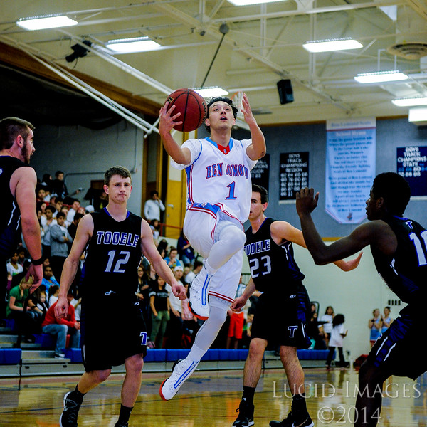 Corbin Medina (1), of Ben Lomond High, flies by almost the entire Tooele High defense on his way to the basket at Ben Lomond High School on January 30, 2015. The Ben Lomond Scots were aggressive and found good shot opportunities, but struggled to make many of their shots in the first half.