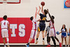 Kinnon Finder (30), of Bonneville, shots over the double team of Ben Lomond defenders Titus Hughes (33) and Sudan Puk (30), at Ben Lomond High School, in Ogden, on Wednesday, January 17, 2018.