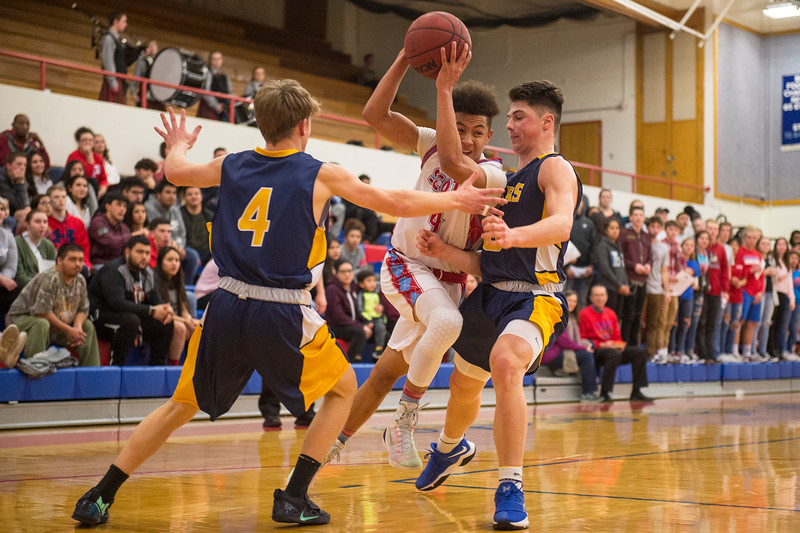 Tayshon Doss (4), of Ben Lomond, tries to drive past the tough defense of Tyler Hancock (0), of Bonneville, at Ben Lomond High School, in Ogden, on Wednesday, January 17, 2018. Ben Lomond got off to a sluggish start with a number of turnovers and many missed shots during the first half allowing Bonneville to take a commanding lead before half time.
