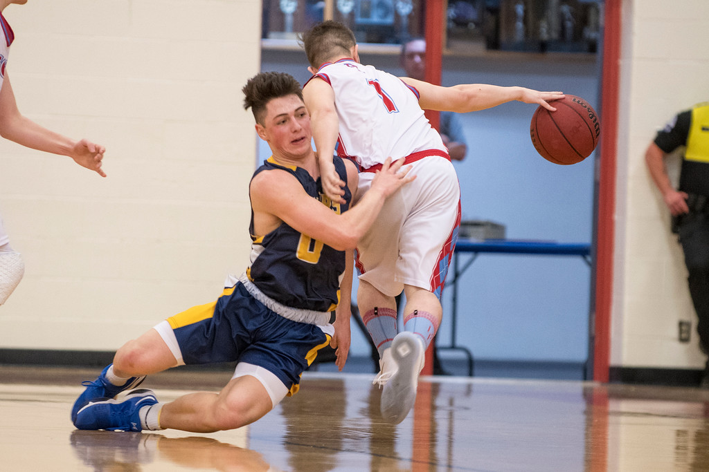 Tyler Hancock (0), of Bonneville, goes to the floor trying to come up with a loose ball but is unsuccessful against Chad Loe (1), of Ben Lomond, at Ben Lomond High School, in Ogden, on Wednesday, January 17, 2018.