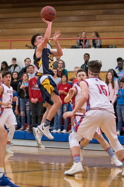 Luke Dixon (20), of Bonneville High, pulls up early during a fast break, opting for a jump shot over the defense of Ben Lomond player, Garet Rentmeister (15), bring Bonneville's lead to 24-8 in the second quarter,  at Ben Lomond High School, in Ogden, on Wednesday, January 17, 2018.