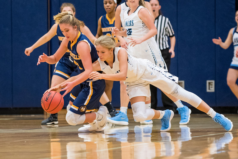Corinne Case, of Layton High (3),  goes to the ground for a loose ball against Bonneville player, K. Conolly (10), at Layton High School, in Layton, on Tuesday, November 21, 2017.