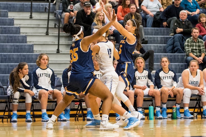 M. Johnson (35) and S. Larsen (5), of Bonneville High, forces Layton to call a time out after trapping Layton player Daisy Barker (12), at Layton High School, in Layton, on Tuesday, November 21, 2017.