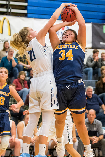 Gracey Criswell (21), of Layton High, blocks the shot of Bonneville player T. Afuvai (34) at Layton High School, in Layton, on Tuesday, November 21, 2017.