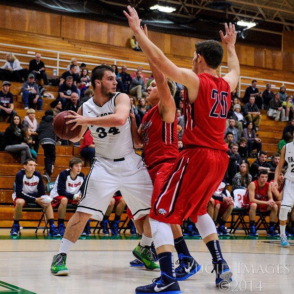 Falcon Carson Maughan (34), gets double teamed by Josh Crowley (24) and Tyler Moon (20) on Clearfield's end of the court at Clearfield High School in Clearfield on January 9, 2015. Woods Cross controlled the tempo of the game with their aggressive defense and full court press during certain parts of the game.