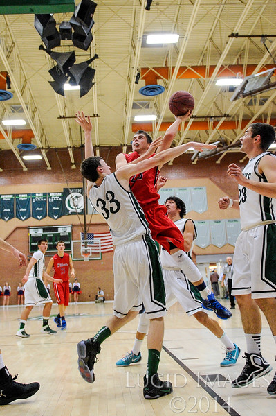 Jordan Lewis (23), of Woods Cross High, gets fouled on a lay-up attempt against Spencer Dixon (33), of Clearfield High at Clearfield High School in Clearfield on January 9, 2015. The Wildcats controlled the tempo of the game with their aggressive defense and the Falcons struggled to get points on the board for much of the first half.