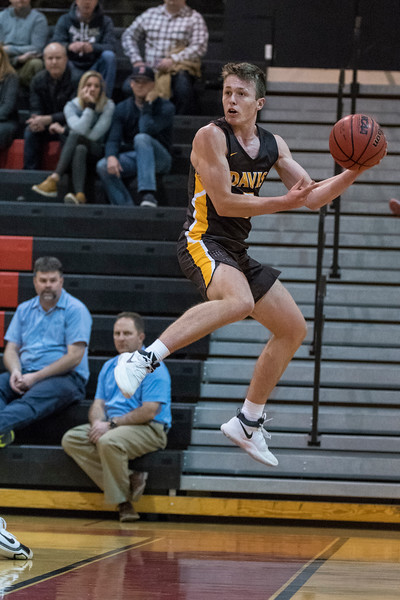 Josh Sanders (5), of Davis, goes airborne to save the ball from going out of bounds, at Weber High School, in Pleasant View, on Tuesday, January 23, 2018.