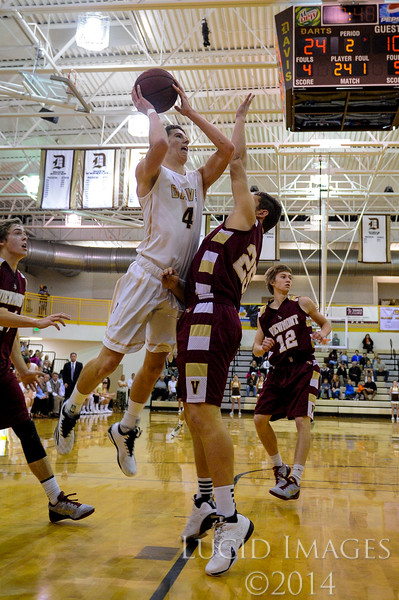 Parker Cristiansen (4), of Davis High, elevates over Max Hadlock (25), of Viewmont High for a lay-up in the first half of the game at Davis High School in Kaysville on January 13, 2015. The game got off to a slow start with agressive defense on both sides, but the momentum swung in Davis' favor and they maintained a double digit lead throughout the first half.