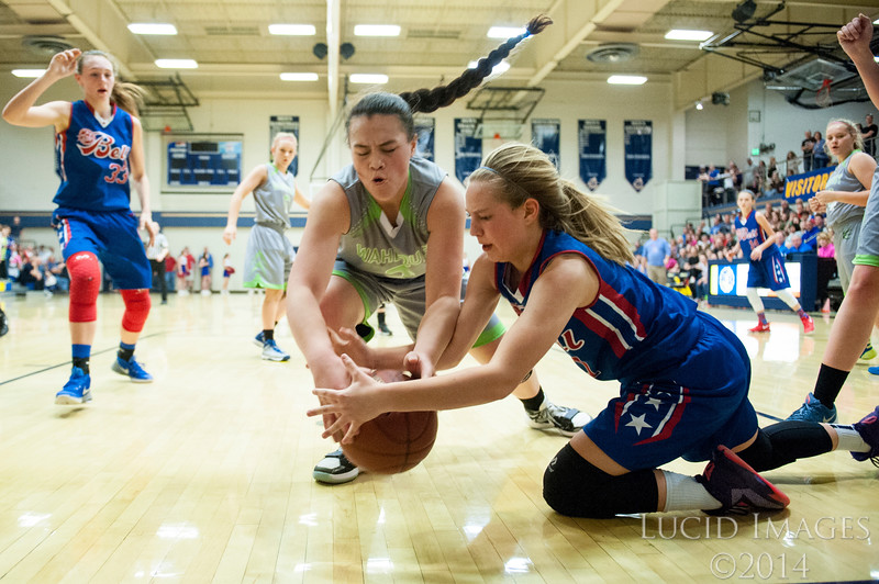 Carriagen Sanders (1), of T.H. Bell Junior High, goes to the ground to fight for a loose ball with Hoku Sagapolu (2), of Wahlquist Junior High, during the Girls Weber School District Basketball Championship Game at Bonneville High School in Washington Terrace, on Friday, March 24, 2017.
