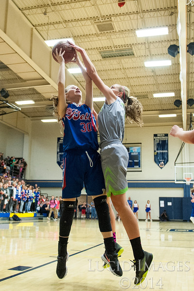 Allison Bird (30), of T.H. Bell Junior High, gets her shot blocked by Walhquist Junior High defender, Sidney East (11), during the Girls Weber School District Basketball Championship Game at Bonneville High School in Washington Terrace, on Friday, March 24, 2017.
