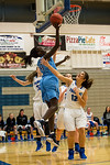 Rachel Odima (41), of Layton High, brings the ball baseline to draw a foul from Fremont player Abby Broadbent (12), during the first half of play at Fremont High School in Plain City, on Dec ...