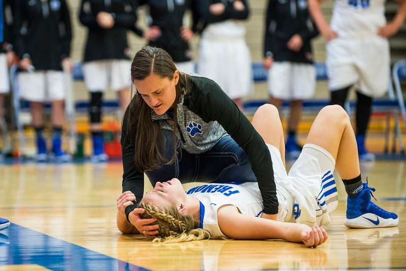 Fremont head coach Lisa Dalebout checks on her player Karstyn Peterson (2), after she took a hard foul by Layton player, Brenda Gallegos (23), on a fast break opportunity, at Fremont High School in Plain City, on December 20, 2016.