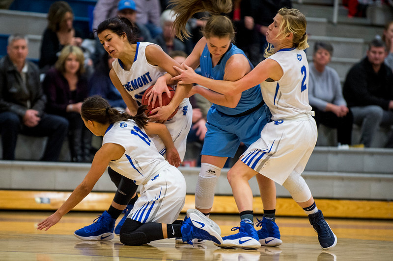Layton player Kaitlyn Viator (33), fights to get the ball away from Fremont player Mazzie Melaney (15), while fending off two other Fremont players, Karlie Valdez (11) and Karstyn Peterson (2), at Fremont High School in Plain City, on December 20, 2016.