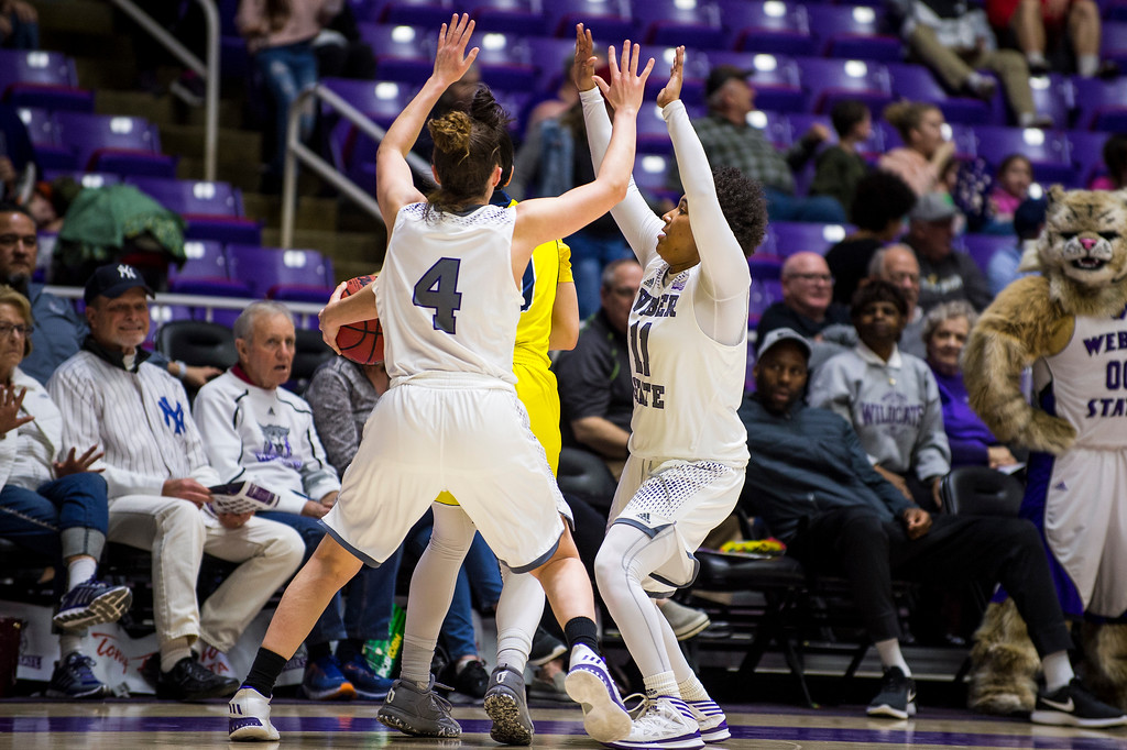 The joint defensive effort of Weber players Kailie Quinn (4) and Larryn Brooks (11), forces Northern Arizona player, Olivia Lucero (11), to call a time out, at the Dee Events Center, in Ogden, on Saturday, February 3, 2018.