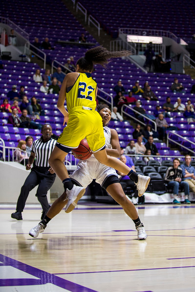 Shianne Johnson (10), of Weber State, makes a smart heads up play, stopping short on her fast break lay up and forcing her defender, Kaprice Boston (22), of Northern Arizona, to sail past her while trying to stop Johnson, at the Dee Events Center, in Ogden, on Saturday, February 3, 2018.