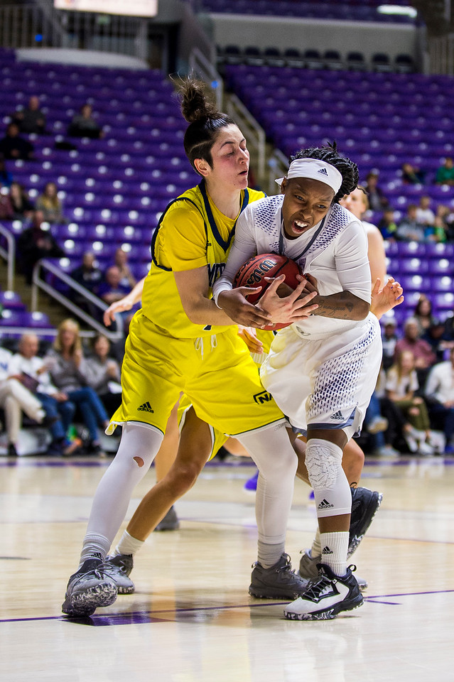 Jaiamoni Welch-Coleman (0), of Weber State, gets stopped on a fast break opportunity and is forced into a jump ball turn over by the defense of Northern Arizona player, Olivia Lucero (11), at the Dee Events Center, in Ogden, on Saturday, February 3, 2018.