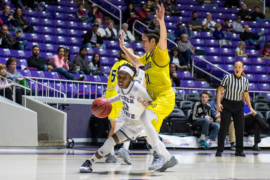 Jaiamoni Welch-Coleman (0), of Weber State, makes a quick break for the baseline, but is forced to make an outlet pass after getting caught by the defense of Olivia Lucero (11), at the Dee Events Center, in Ogden, on Saturday, February 3, 2018.