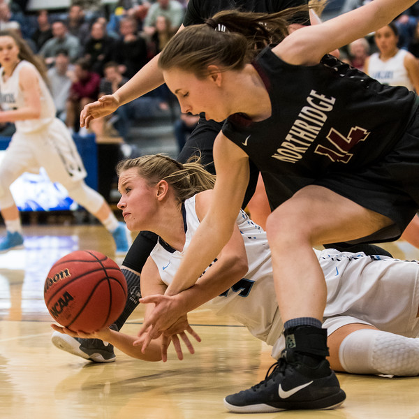 Corinne Case (3), of Layton, dives to the floor for control of a loose ball while Jennica Hess (14), of Northridge, tries to thwart her efforts, at Layton High School in Layton, on Wednesday, January 3, 2018.
