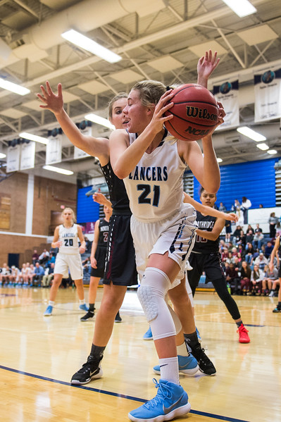 Kambree Christensen (15), of Northridge, traps Gracey Criswell (21), of Layton, in the corner, forcing a Layton turnover, at Layton High School in Layton, on Wednesday, January 3, 2018.