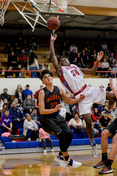 Stephen Watson (34), of Ben Lomond, gets called with an offensive foul after Isaiah Coria (23), of Ogden High, plants himself squarely in the way of Watson's fast break attempt at Ben Lomond High School, in Ogden, on Wednesday, February 14, 2018.