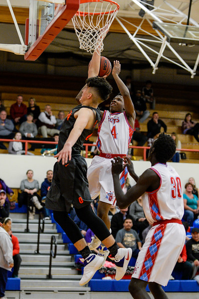 Stephen Watson (34), of Ben Lomond, makes a great move to catch a pass and score through the defense of Isaiah Coria (23), of Ogden High, at Ben Lomond High School, in Ogden, on Wednesday, February 14, 2018.