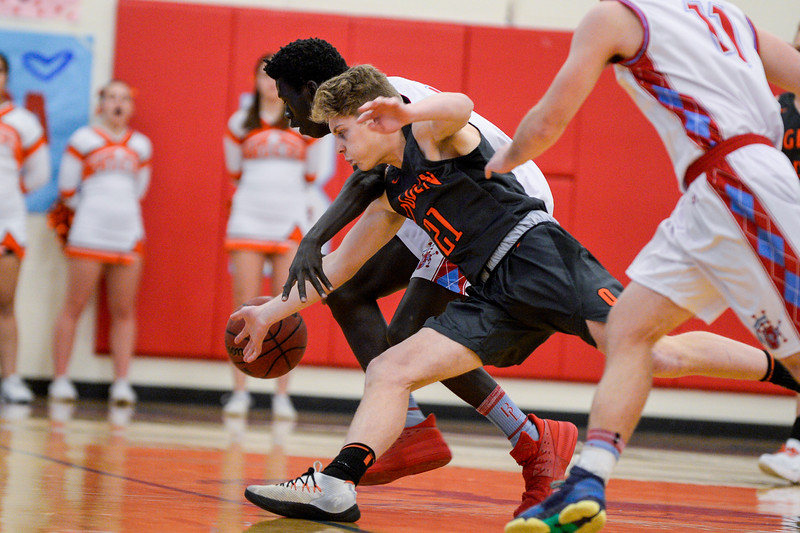 Sudan Puk (30), of Ben Lomond, hustles to steal back a ball that had just been taken from him after an offensive board by Cooper Jones (21), of Ogden High, at Ben Lomond High School, in Ogden, on Wednesday, February 14, 2018.