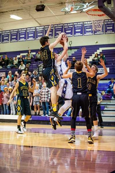 Justin Boley (24), of Roy, blocks the shot attempt of Box Elder player, Max Watson (1) after Watson came up with an offensive rebound at Box Elder High School in Brigham City on December 16, 2015.