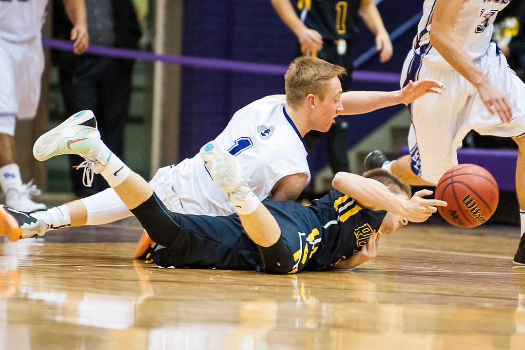 Max Watson (1), of the Bees, fights for a loose ball with Roy High player, Rex Carpenter (3), at Box Elder High School in Brigham City on December 16, 2015.