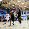 Sealun Erskine (12), of Bonneville High, gets fouled hard while attempting to lay up the basketball, by Roy defender Jaycob Payne, at Bonneville High School on January 28, 2015.