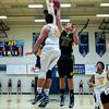 Bonneville Laker, Ethan Atagi (45), blocks the shot of Roy Royal, Blake Lamb (31), to force a fast break opportunity for the Lakers, at Bonneville High School on January 28, 2015.