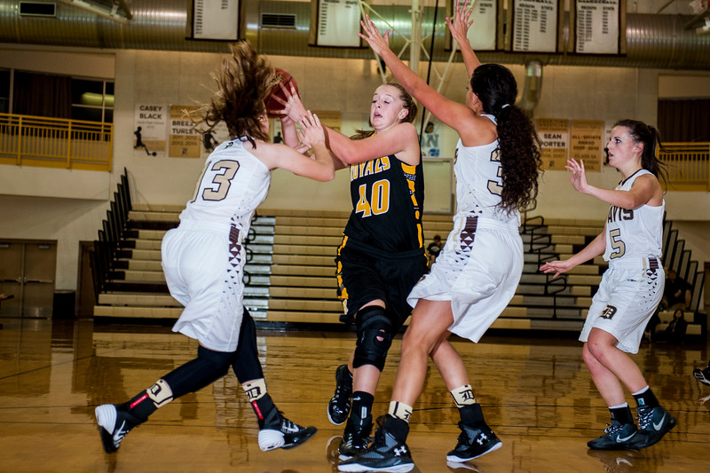 Josie Williams (40), of Roy, draws the attention of two Davis High defenders, but makes a bad pass out of bounds, trying to get the ball to her open teammate at Davis High School in Kaysville on December 10, 2015.