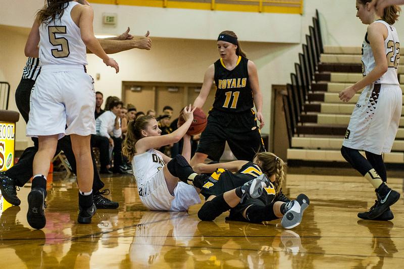 Lindsey Reich (13), of Davis, battles Brittney Hatch (23), of Roy, for a loose ball near center court at Davis High School in Kaysville on December 10, 2015.