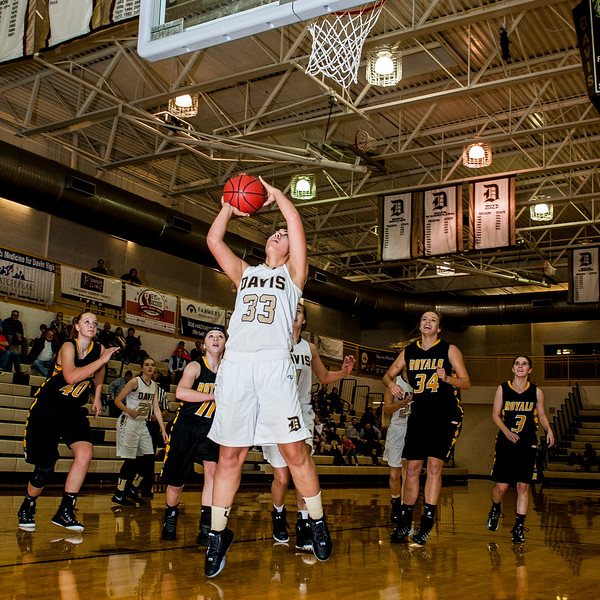 Good ball movement and a near turnover left Malia Tupuola (33), of Davis High, wide open under the basket for an easy two points against Roy High at Davis High School in Kaysville on December 10, 2015.