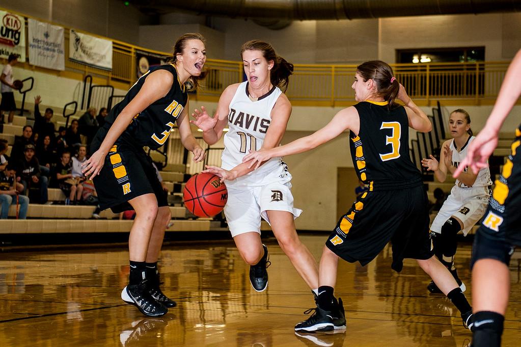 McKinlay Otterson (11), of Davis, splits Roy defenders Maryka Jansen (34, left) Katie Bloxham (3, right) at Davis High School in Kaysville on December 10, 2015.