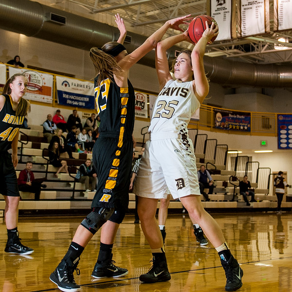 Savanna Williams (33), of Roy High, challenges Shelbi Harmon (25), of Davis High, before she can even make an attempt on the basket at Davis High School in Kaysville on December 10, 2015. Roy's tough defense earned them an early lead that they built upon for the remainder of the game.