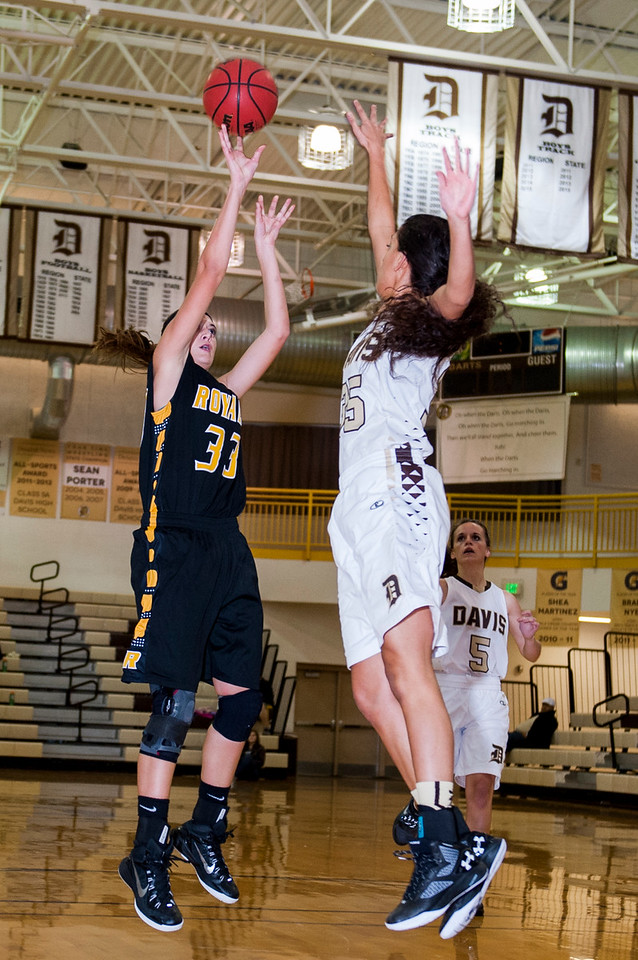 Sophie Vasquez (35), of Davis High, tries to contest the shot of Savanna Williams (33), of Roy High, in a lopsided first half that Roy got ahead 24-10 at Davis High School in Kaysville on December 10, 2015.