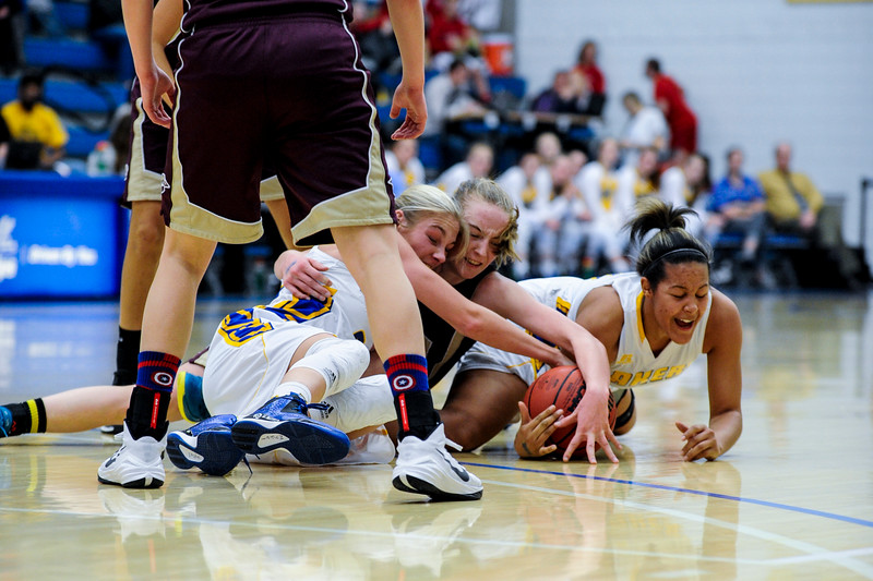 Bonneville Laker Mykel Davis (left) joins teammate Shayla Simpson (right) in the fight for a loose ball against Maple Mountain player Liz Eaton (center) during the 4A Girls Prep Basketball Tournament at Salt Lake Community College in Salt Lake City on February 17, 2015.
