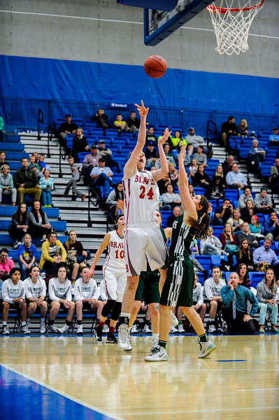 Bountiful center Kennedy Redding (24), posts up on the baseline for a lay up over the defense of Olympus player Makenna Park (5) at the 4A Girls Prep Basketball Tournament at Salt Lake Community College in Salt Lake City on February 17, 2015.