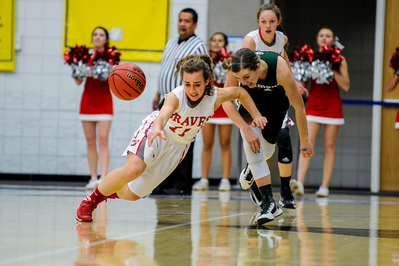Sophia Skedros (11, white uniform), of Bountiful, tries to hustle after the loose ball that she stole away from Olympus player Kyra Johnson (3), at the 4A Girls Prep Basketball Tournament at Salt Lake Community College in Salt Lake City on February 17, 2015.
