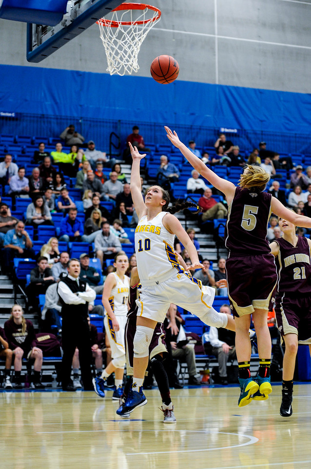 Hannah Shore (10), goes in for a lay up and scores against the defense of Maple Mountain player Liz Eaton (5), during the 4A Girls Prep Basketball Tournament at Salt Lake Community College in Salt Lake City on February 17, 2015.