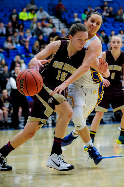 Bonneville defender Hannah Shore (10, white uniform) reaches in to knock the ball loose from Maple Mountain player Elli Eastmond (15), during the 4A Girls Prep Basketball Tournament at Salt Lake Community College in Salt Lake City on February 17, 2015.