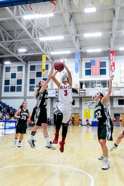 Amy Chidester (3), of Bountiful, drives right up the lane for a lay up, splitting the defense of Olympus players Katie Warren (10) and Samantha Soltis (22) at the 4A Girls Prep Basketball Tournament at Salt Lake Community College in Salt Lake City on February 17, 2015.