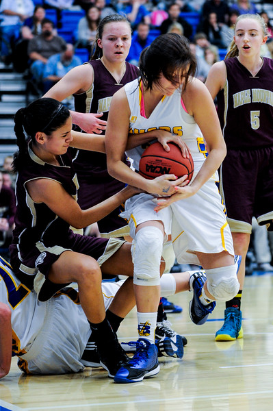 Ellen Jensen (25), of Bonneville, fights hard for an offensive rebound against Maple Mountain player Nicole Heyn (3) during the 4A Girls Prep Basketball Tournament at Salt Lake Community College in Salt Lake City on February 17, 2015.