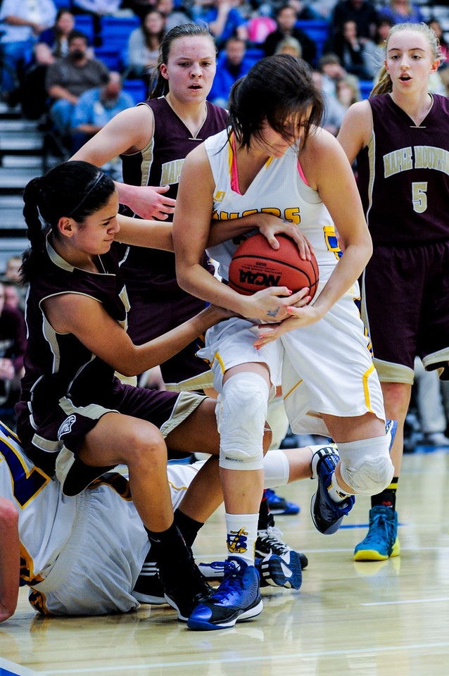 Ellen Jensen (25), of Bonneville, fights hard for an offensive rebound against Maple Mountain player Nicole Heyn (3) during the 4A Girls Prep Basketball Tournament at Salt Lake Community College in Salt Lake City on February 17, 2015.