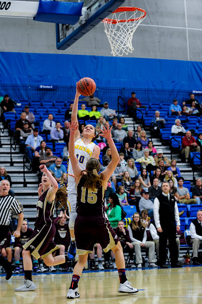 Bonneville Laker Hannah Shore (10), goes up for a lay up over the defense of Maple Mountain player Elli Eastmond (15), during the 4A Girls Prep Basketball Tournament at Salt Lake Community College in Salt Lake City on February 17, 2015.